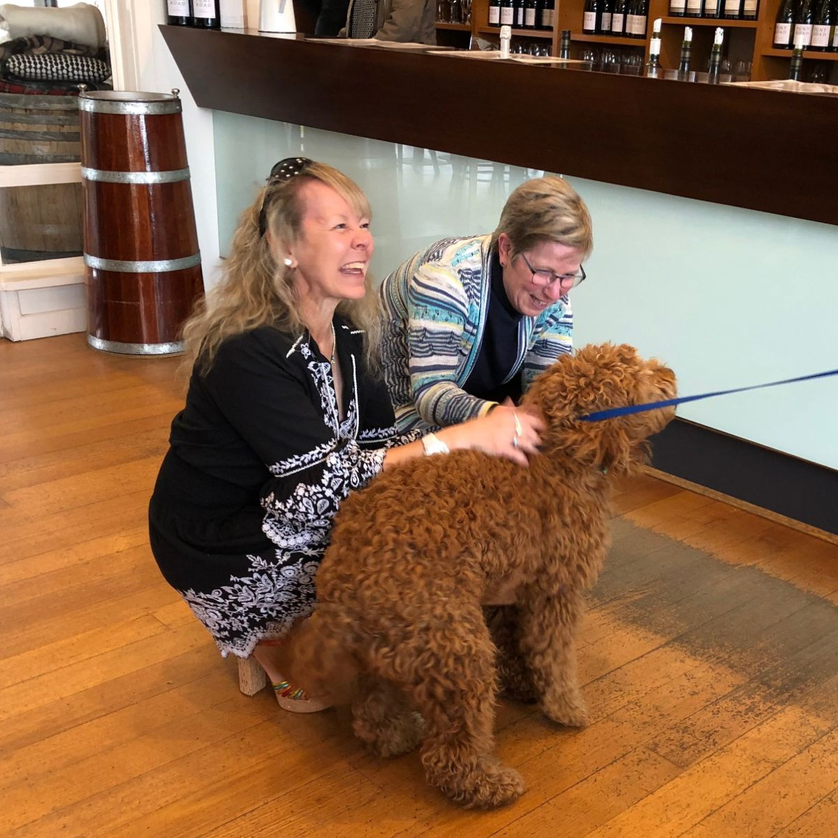 crazy happy women on a pooches and pinot wine tour