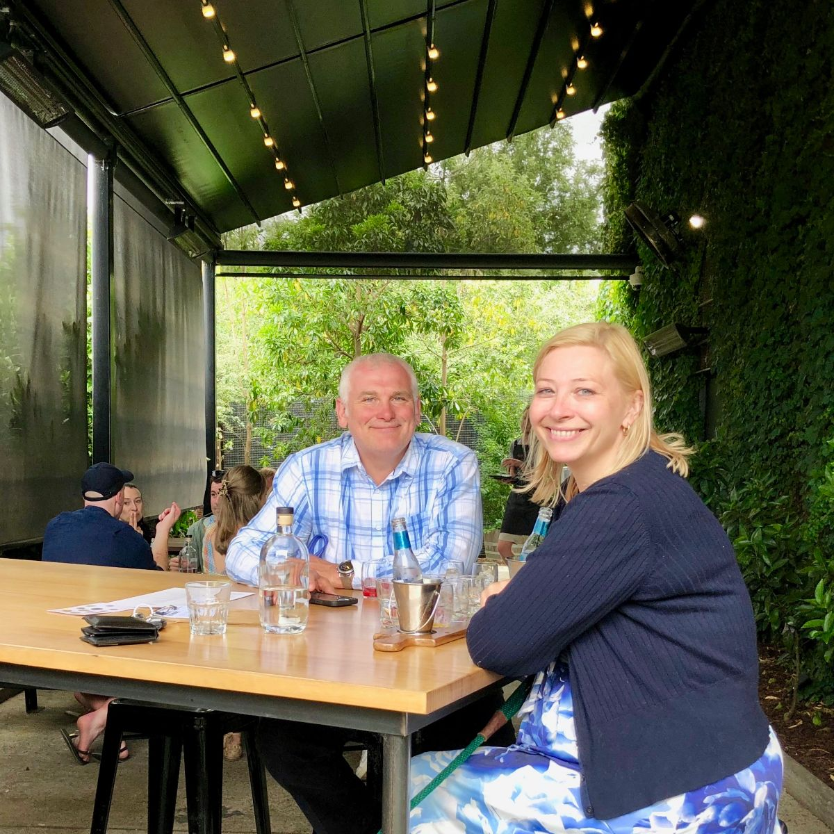 couple celebrating their wedding anniversary on a doggy wine tour with Pooches and Pinot